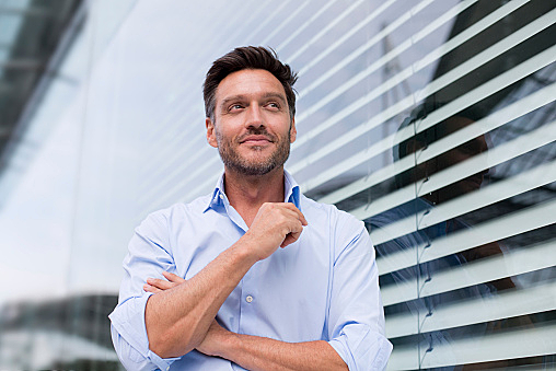 Portrait of mature businessman outside office building